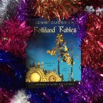 Folkland Fables book surrounded by tinsel