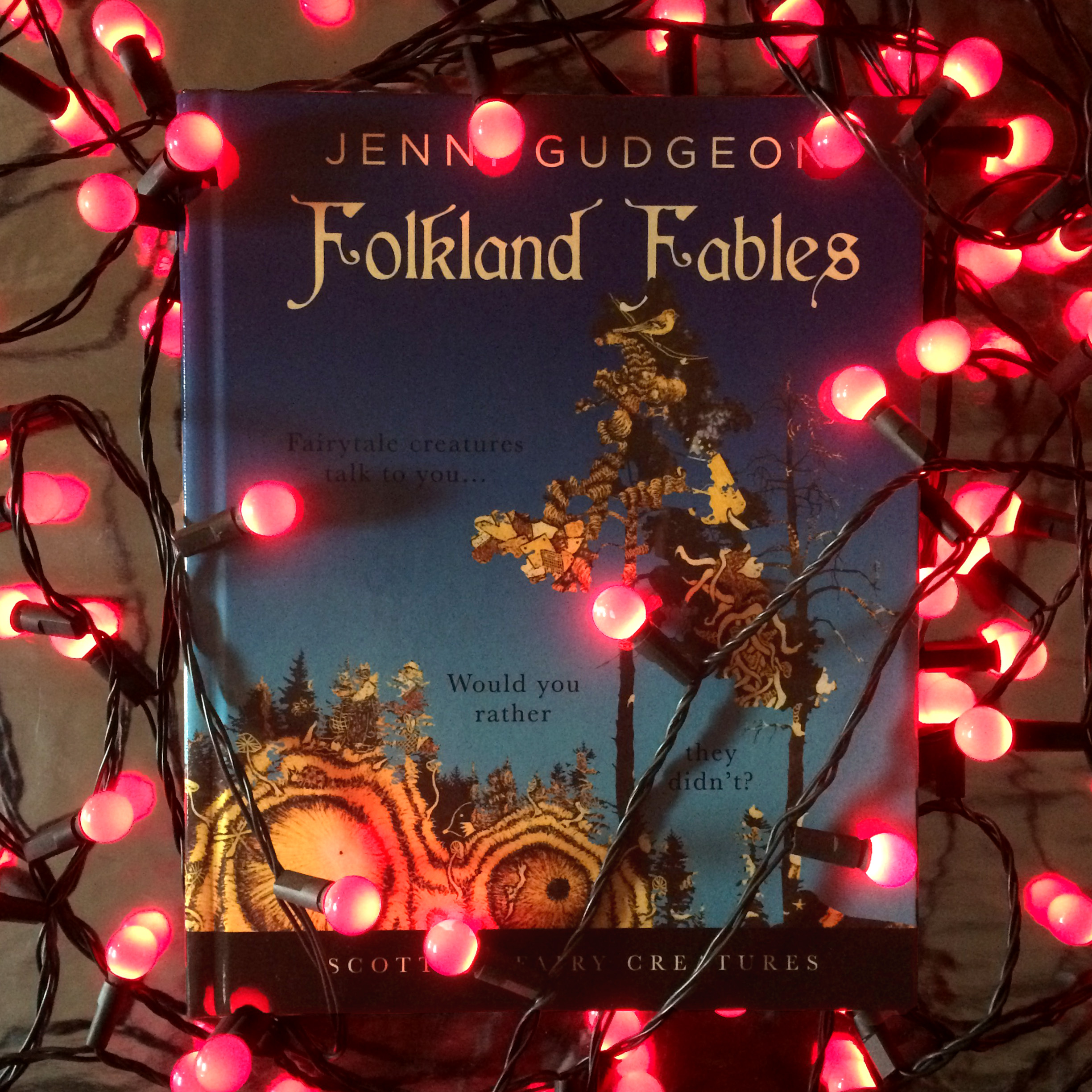 Folkland Fables book with fairy lights